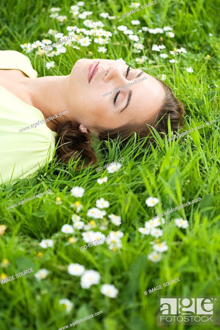 Stock Photo: Woman sleeping on grass.