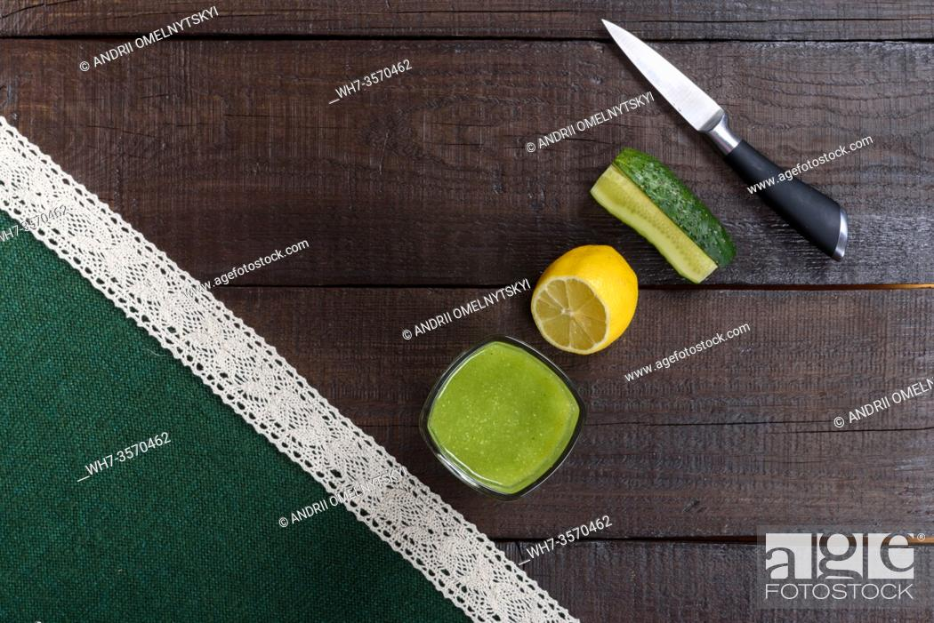 Stock Photo: cucumber smoothie with lemon and sugar on wooden background.