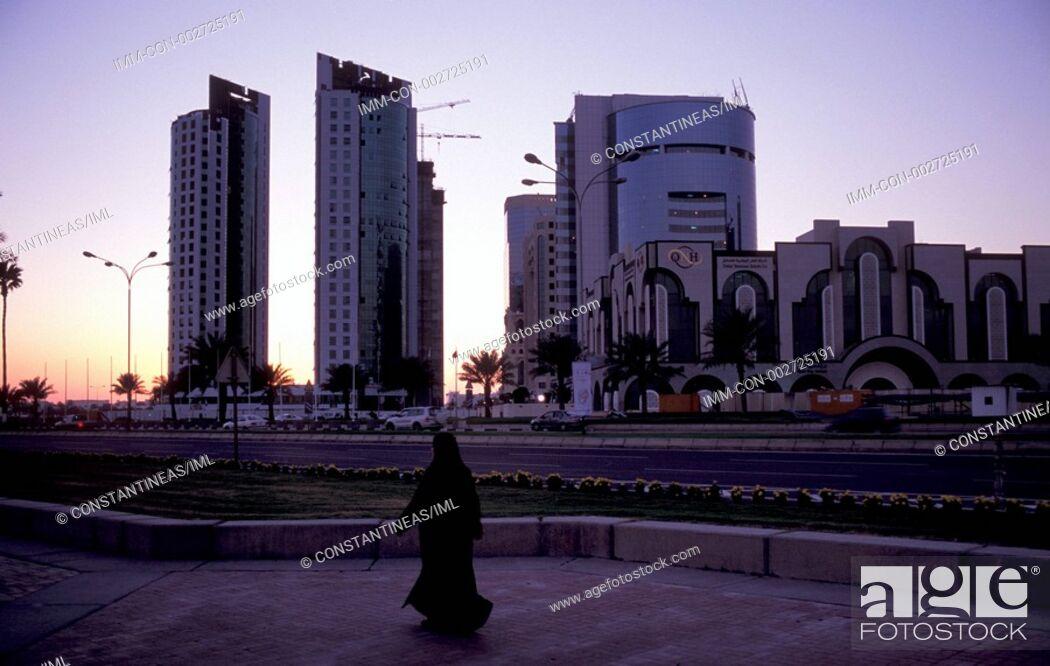 Stock Photo: Woman walking along the Corniche pedestrian street, Doha, Qatar, Middle East.