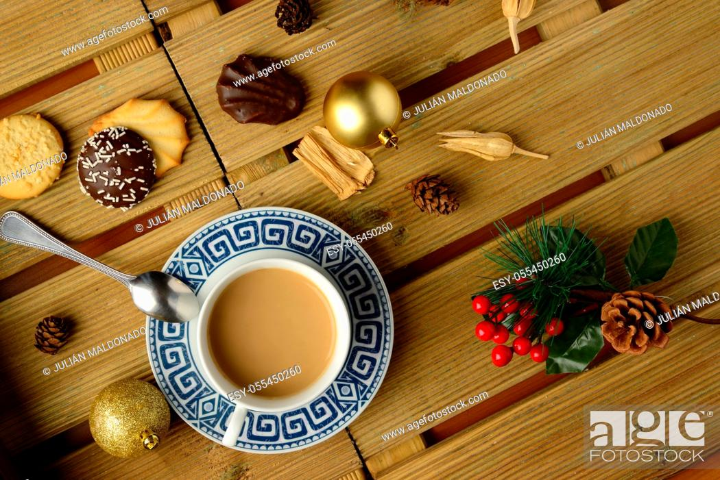 Stock Photo: Cup of coffee with milk and pasta with Christmas decorations.