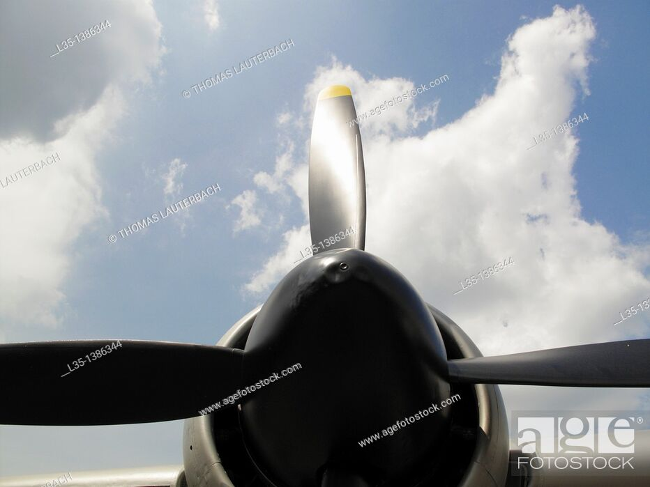 Stock Photo: Propeller and white clouds.