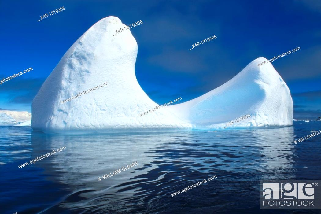 Stock Photo: Sculpted Icebergs in Antarctica.