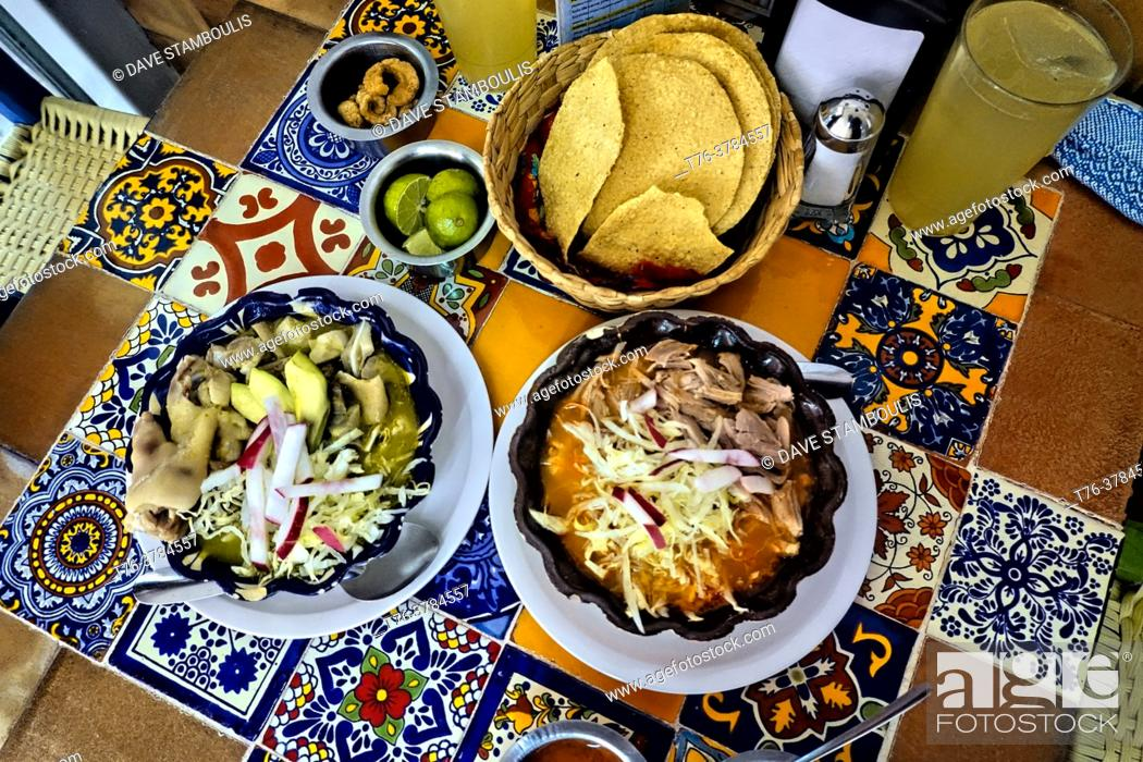 Stock Photo: Spicy red and green pozole, a speciality in Guadalajara, Jalisco, Mexico.