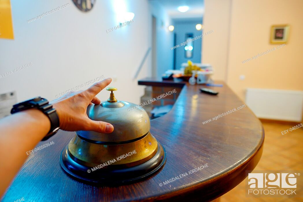 Stock Photo: Hand ringing in service bell at hotel.