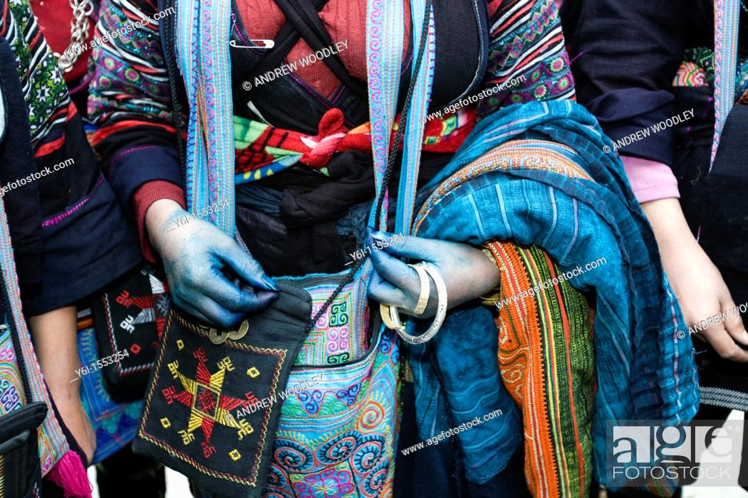Stock Photo: Black Hmong hilltribe woman with blue hands from dyed cloth Sapa Vietnam.