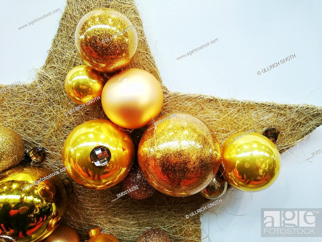 Stock Photo: Bright Christmas decoration made of a star with baubles.