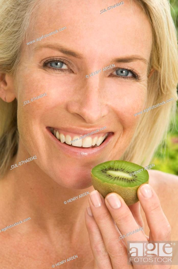 Stock Photo: Portrait of woman healthy eating.