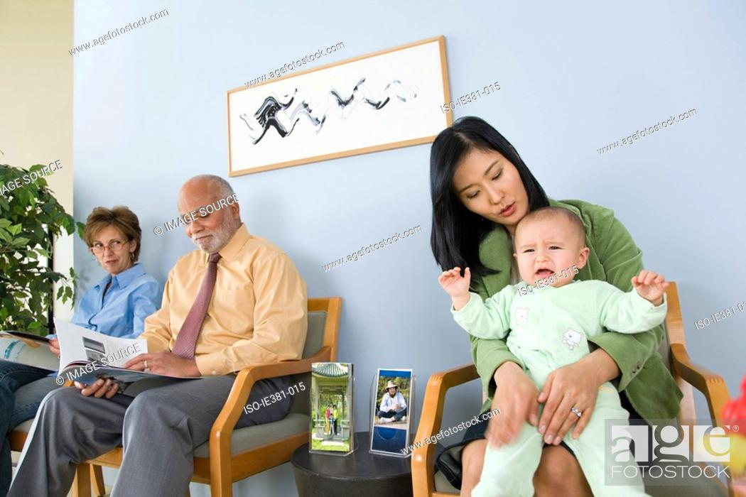 Stock Photo: Patients waiting in a doctors office.