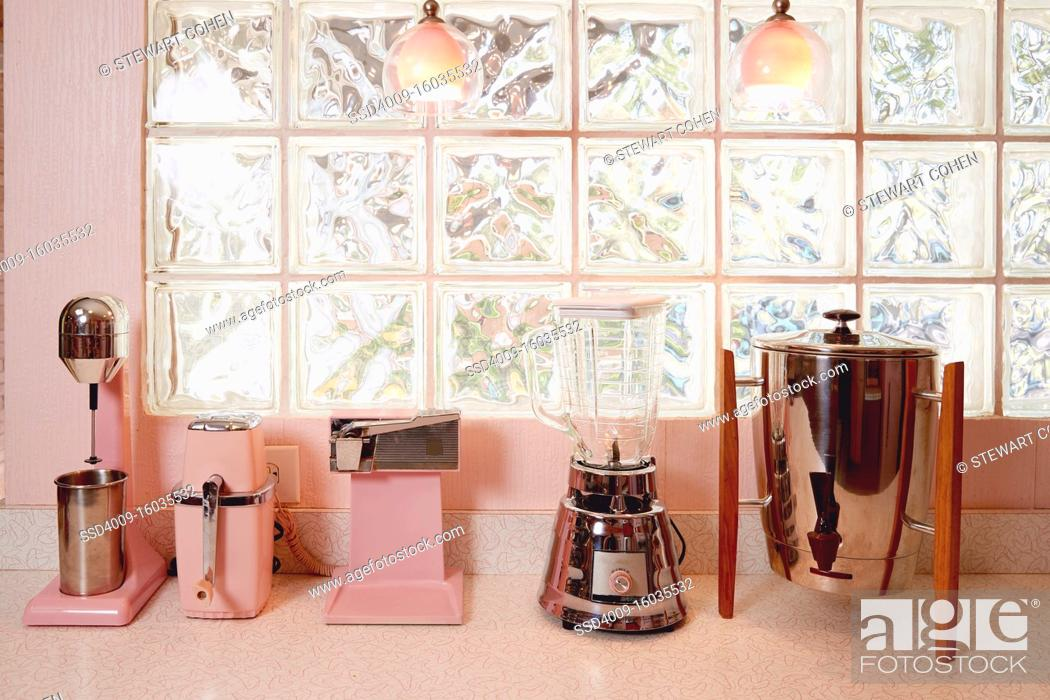 Photo de stock: Detail of pink vintage kitchen and pink vintage appliances in a mid century kitchen.