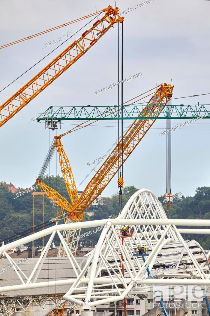 Stock Photo: Giant cranes supporting metal structure, Truss Placement, Anoeta Stadium Cover, Amara, Donostia, San Sebastian, Gipuzkoa, Basque Country, Spain.
