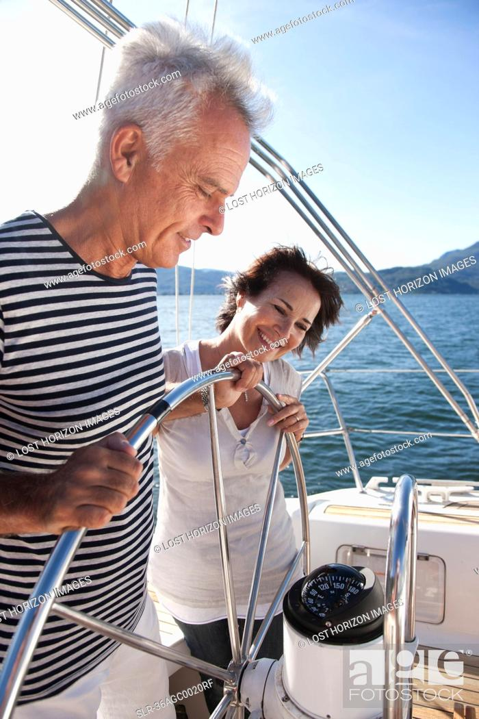 Stock Photo: Older couple sailing together.