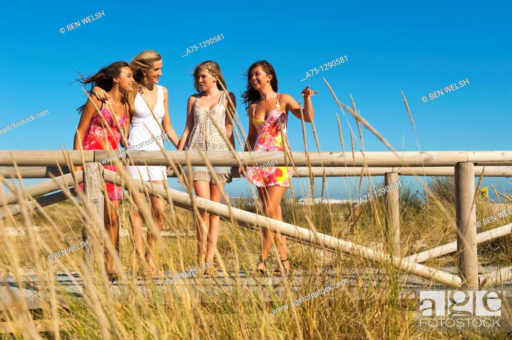 Stock Photo: Young girls on the beach.