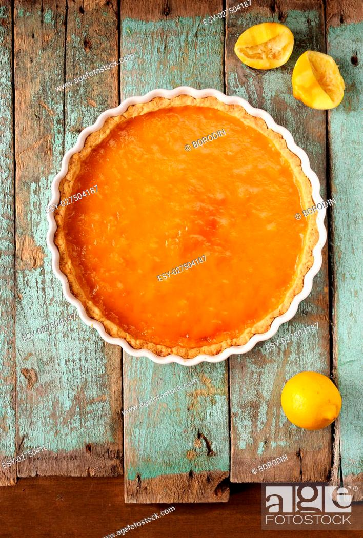 Stock Photo: Lemon pie with fresh and squeezed lemon overhead view.