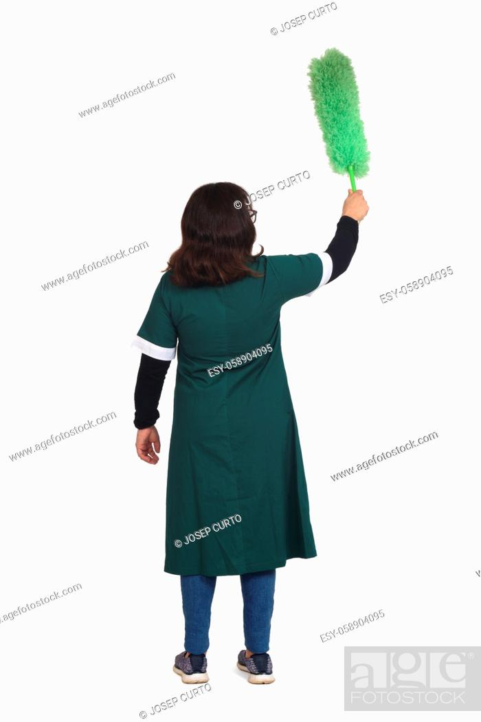 Stock Photo: rear view of a latin woman dusting with a duster on white background.
