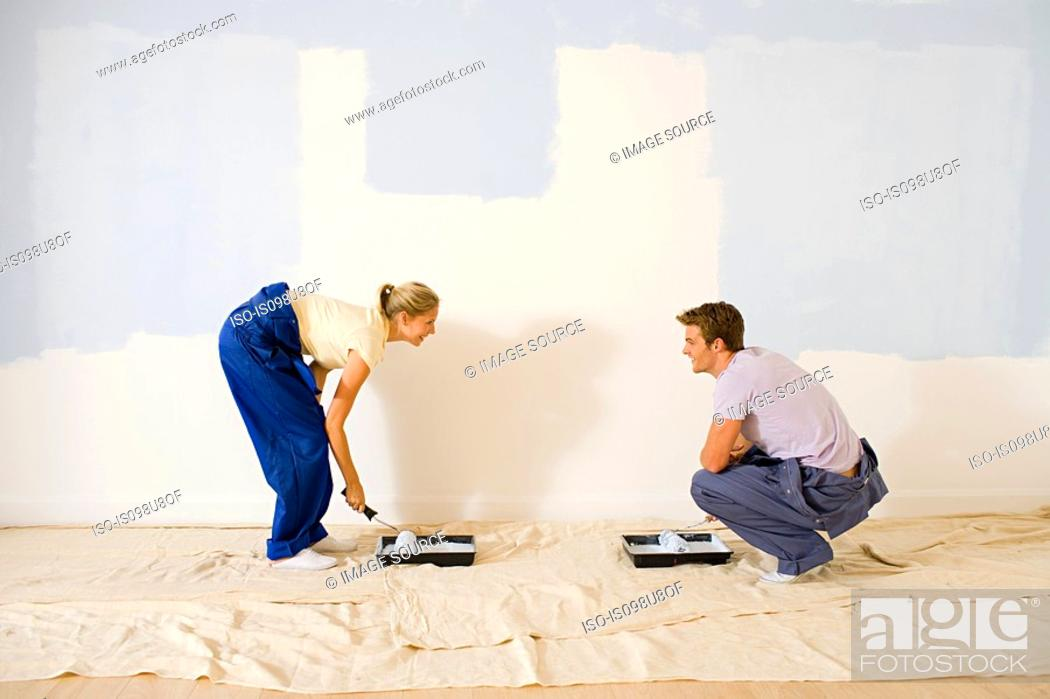 Stock Photo: Young couple decorating.