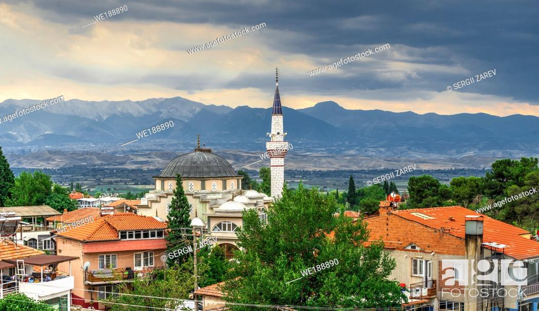 "Stock Photo: Pamukkale, Turkey â. "" 07. 14. 2019. Panoramic view of Pamukkale village on a cloudy summer evening."