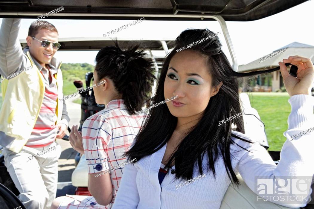 Stock Photo: Portrait of a woman sitting inside a golf cart.