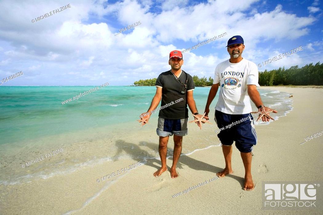Stock Photo: Local men with starfish, Ile aux Cerfs, Mauritius, Indian Ocean.
