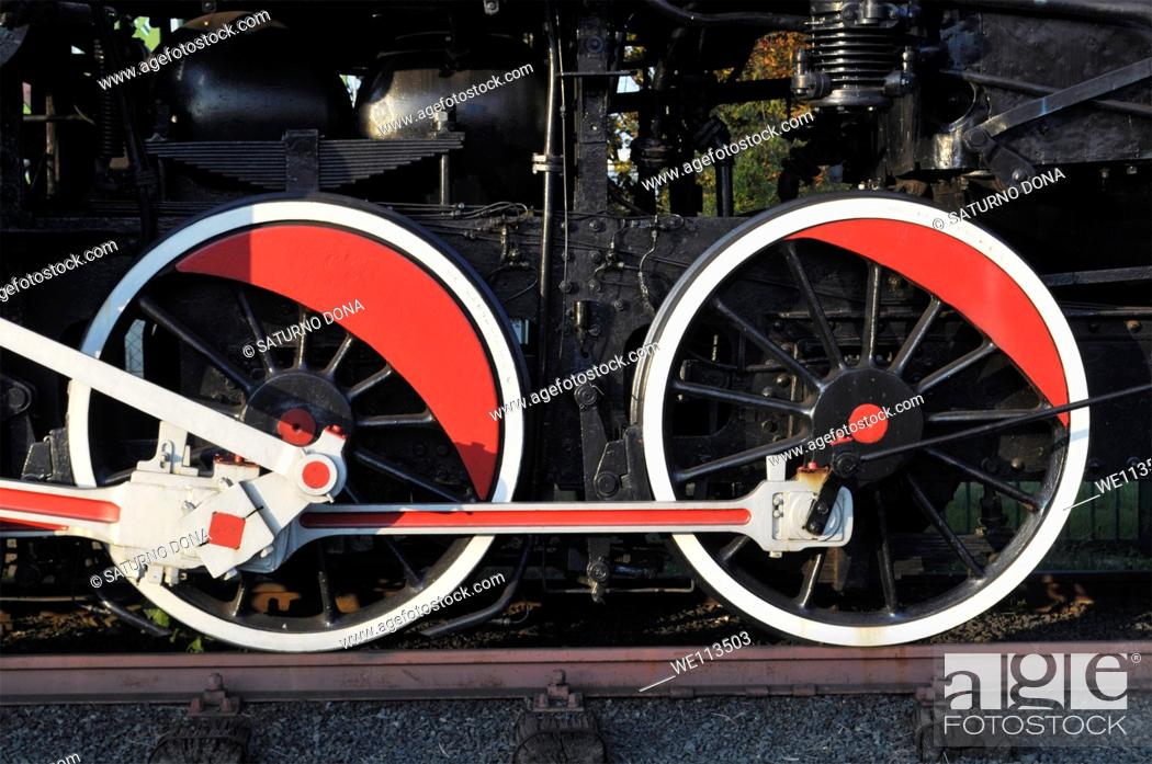 Stock Photo: Red and white wheel of an old steam engine train.