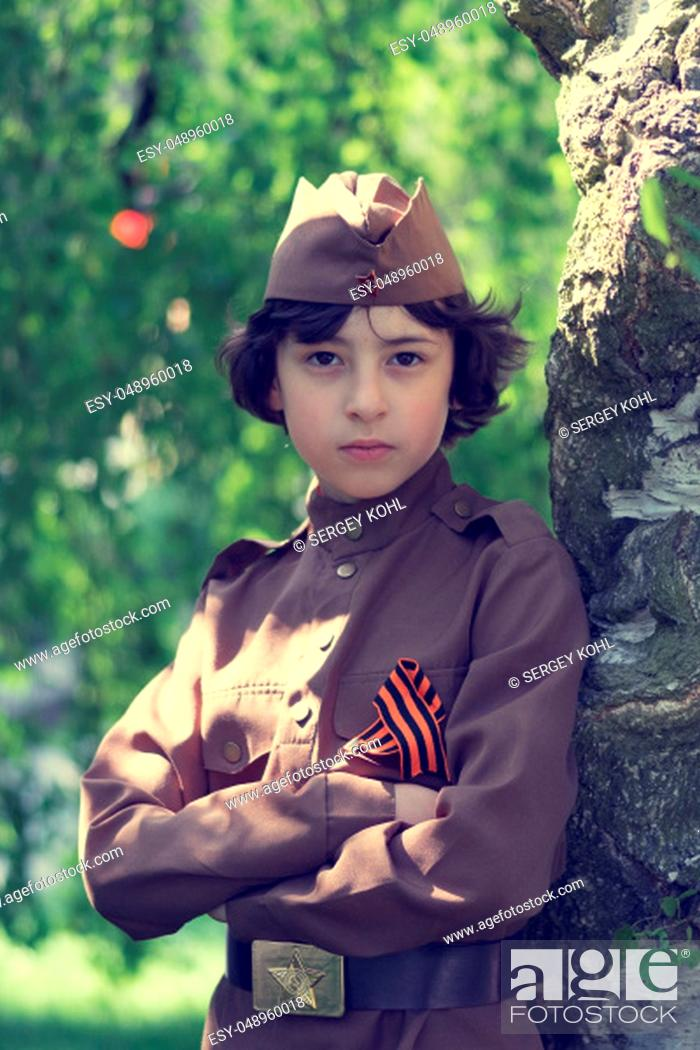 Imagen: Portrait of a boy in the uniform of a soldier of the Red Army during the Second World War. Stylization. Retro toning.