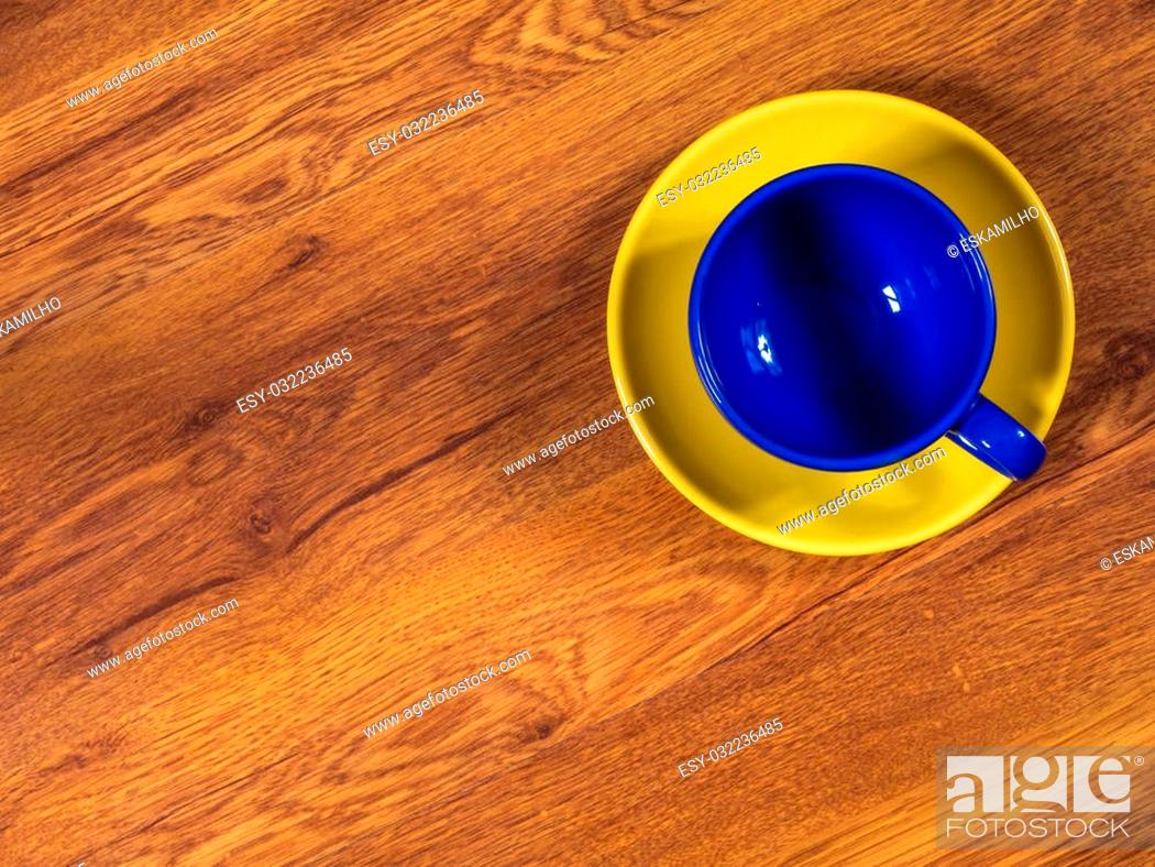 Stock Photo: Top view on the cup with saucer, standing on the wooden table.