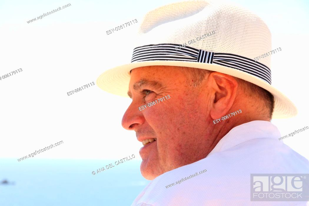 Stock Photo: Portrait of a handsome man in withe with hat Spain.