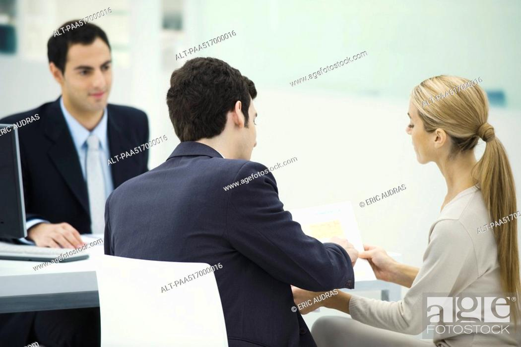 Stock Photo: Professional meeting with clients, couple analyzing document together.