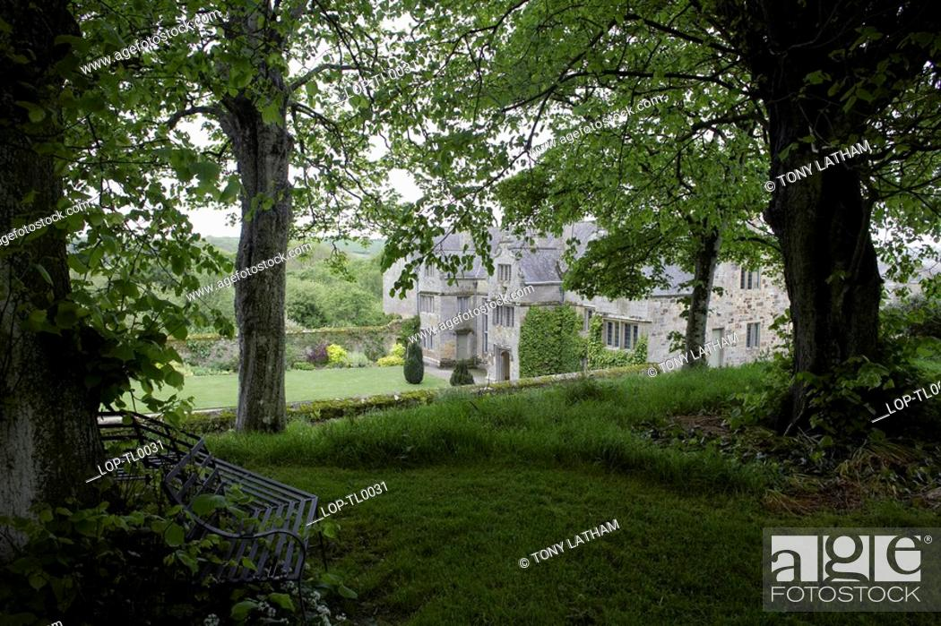 Stock Photo: A view through trees toward Trerice House. The house was built in 1573 by Sir John Arundell, replacing a home that he inherited from his father.