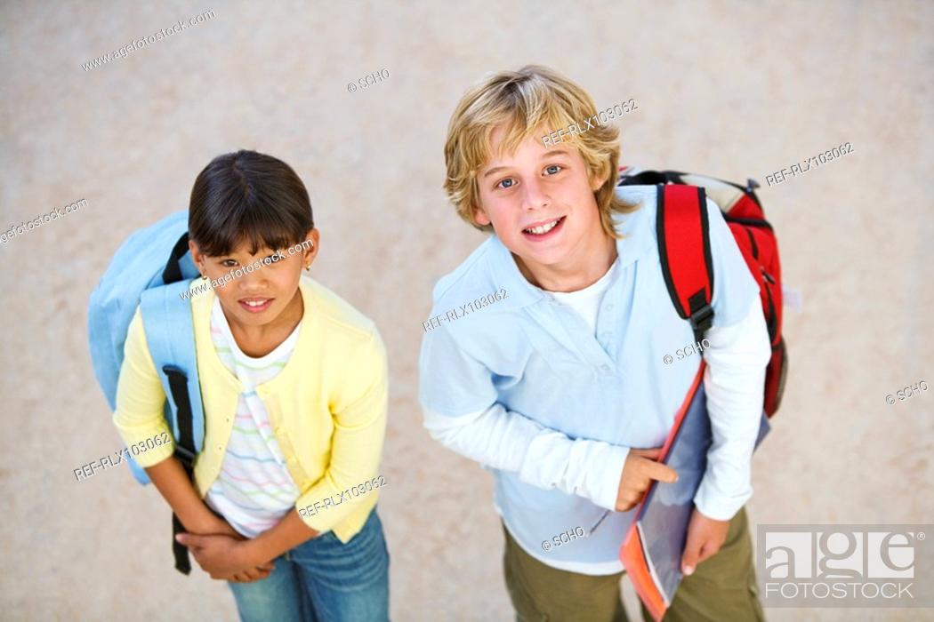 Stock Photo: Two school children 10-13 waiting, from above.