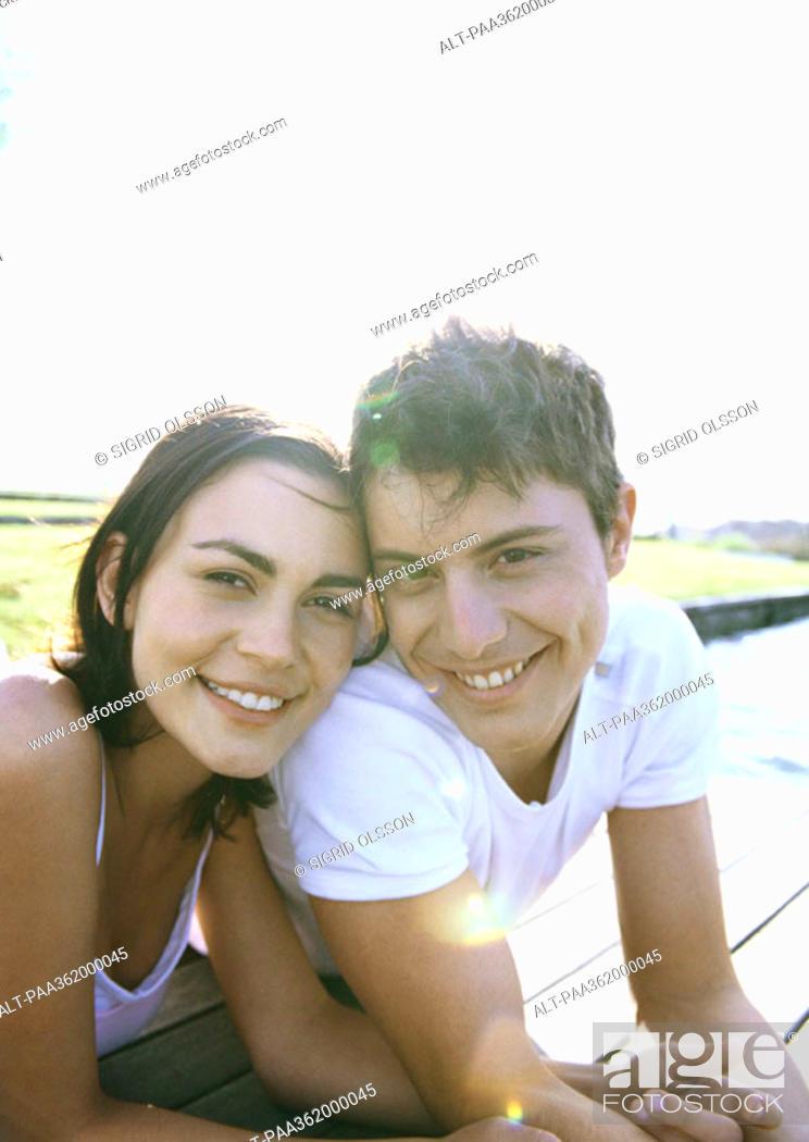 Stock Photo: Young couple lying on dock.