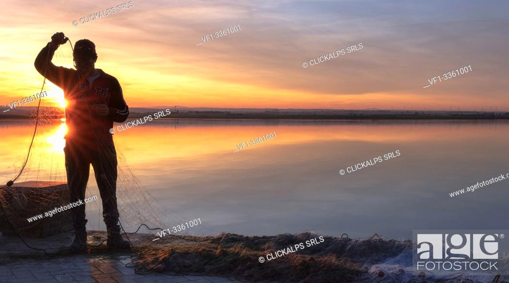 Stock Photo: Lesina lake at sunset, Lesina village, Foggia district, Apulia, Italy.