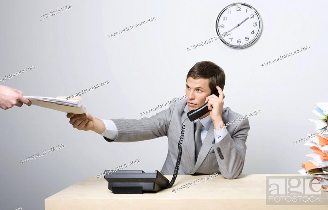 Stock Photo: Businessman talking on telephone.