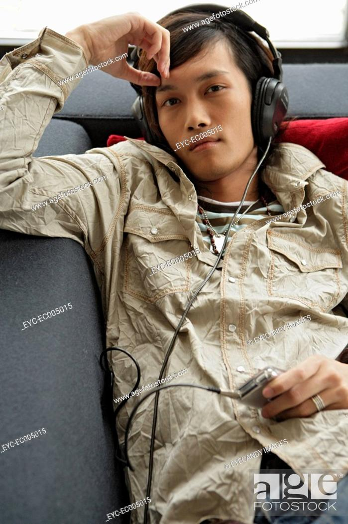 Stock Photo: Portrait of young man hearing music.