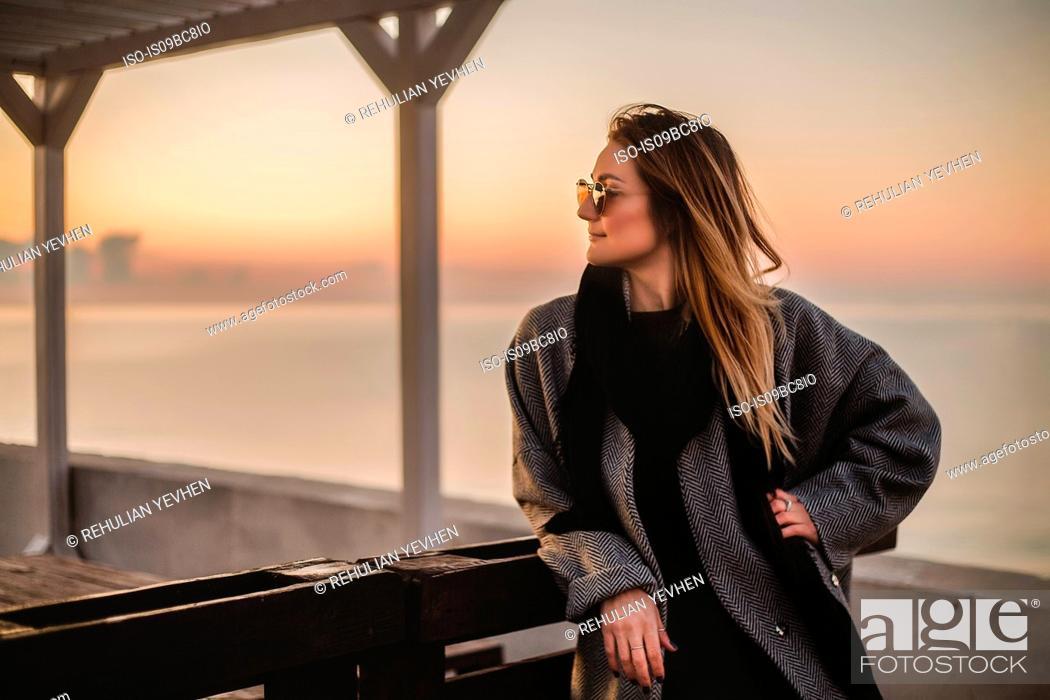 Stock Photo: Portrait of woman wearing winter coat and sunglasses looking away, Odessa, Odeska Oblast, Ukraine.