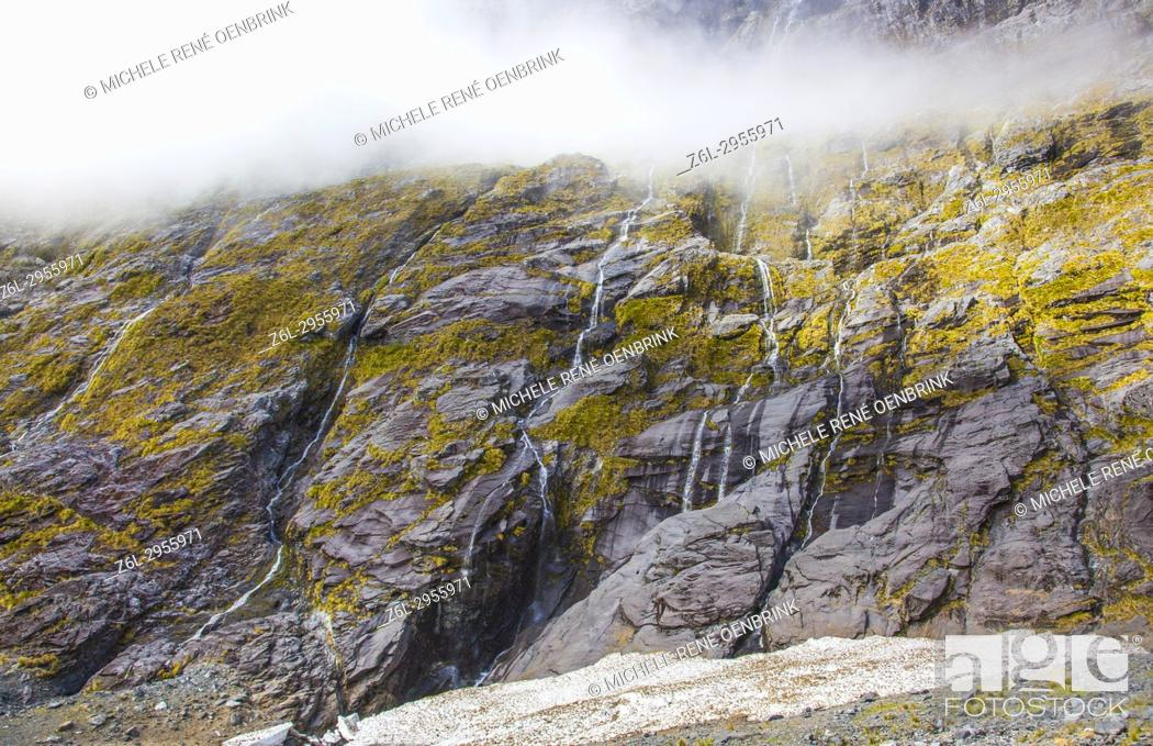 Stock Photo: Waterfalls flowing down mountains from snowtops mountains in New Zealand.