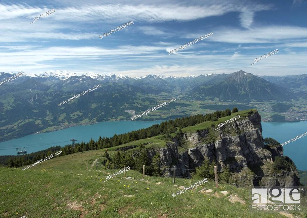 Imagen: View of the mountain station at Niederhorn with Lake Thun and mountain range of the Bernese Alps, Canton of Bern, Switzerland, Europe.