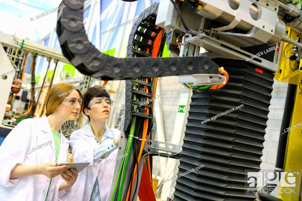 Stock Photo: Robotic mobile platform for aeronautical drilling. Researchers working on portable robot to drill holes into aircraft components, Industry.
