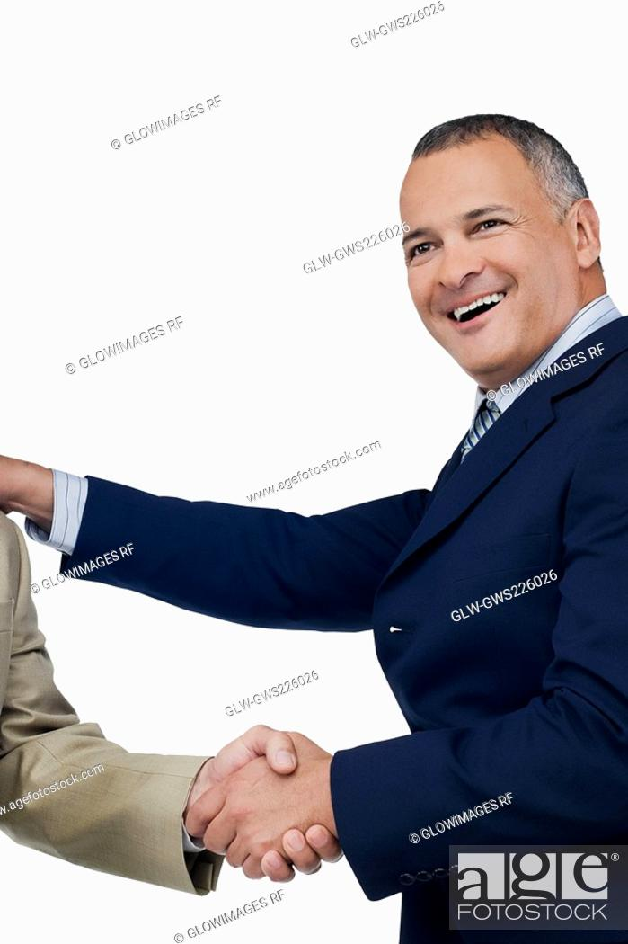 Stock Photo: Businessman shaking hands with another businessman.