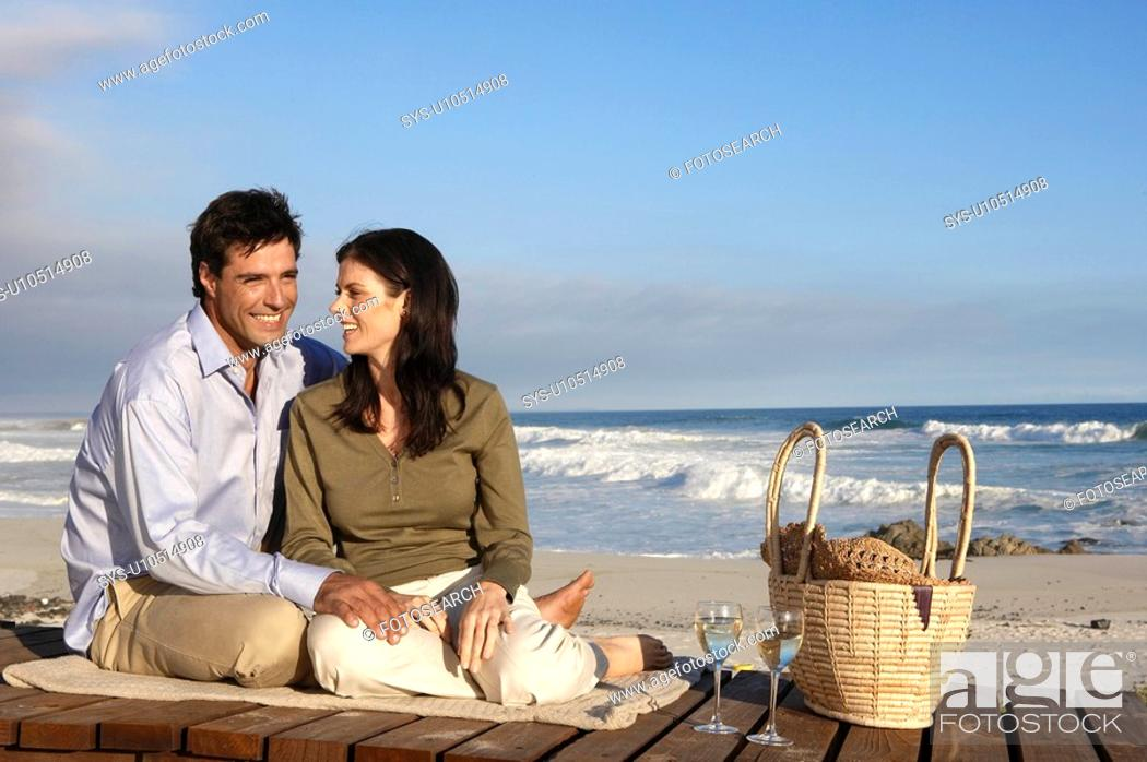 Stock Photo: Couple drinking wine on beach, Cape Town, South Africa.