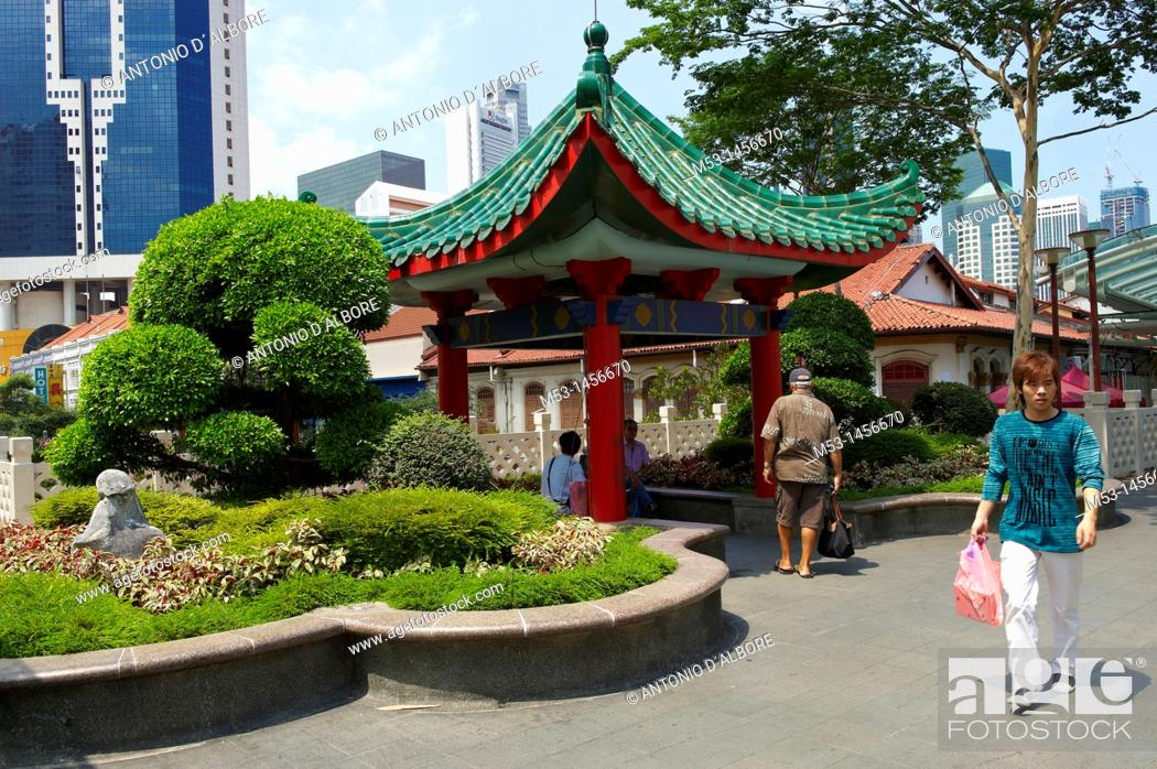 Stock Photo: Formal garden and chinese style pagonda on an elevated walkway in Eu Tong Sen Street in chinatown district  Singapore.