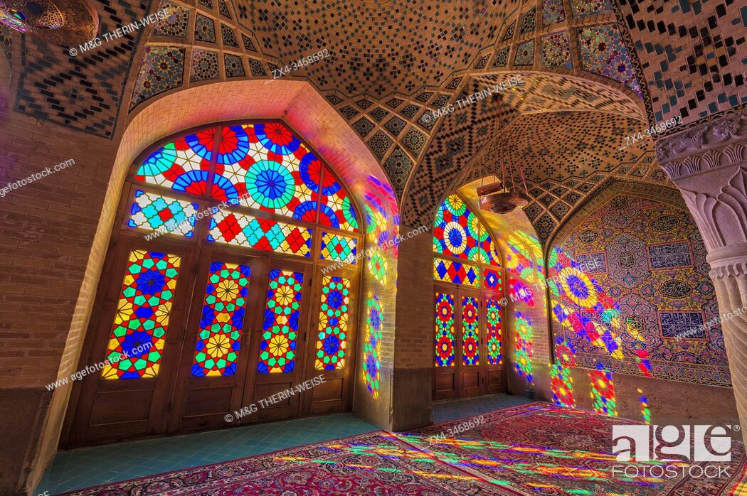 Photo de stock: Nasir-ol-Molk Mosque or Pink Mosque, Light patterns from colored stained glass illuminating the iwan, Shiraz, Fars Province, Iran, Asia.