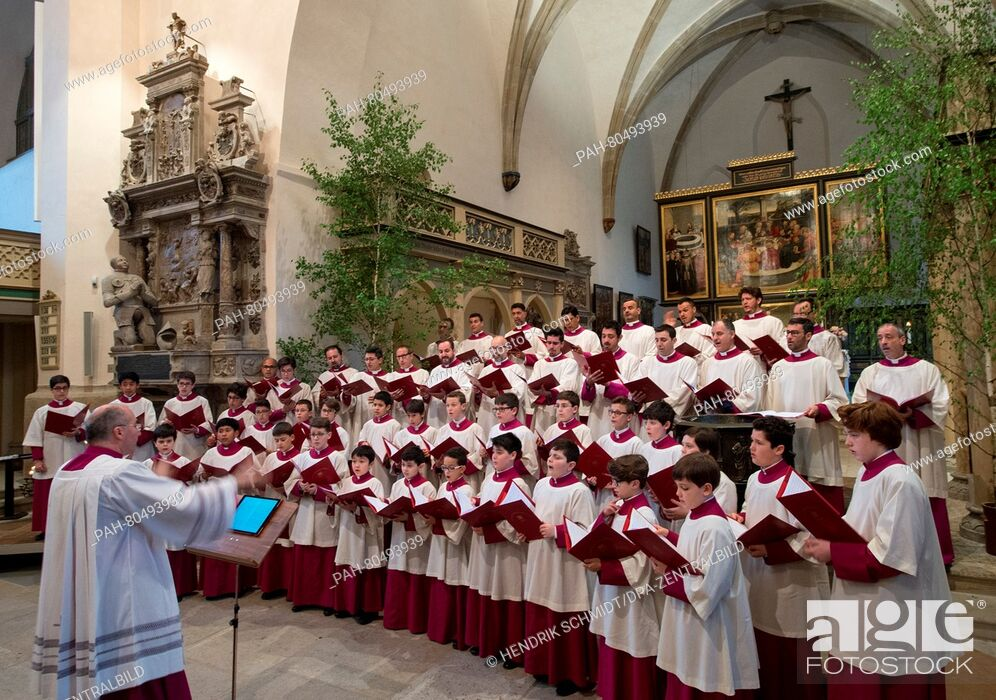 Stock Photo: The Vatican-based Sistine Chapel Choir led by its director Massimo Palombella (front L) performs during a rehearsal prior to an ecumenical concert held at the.