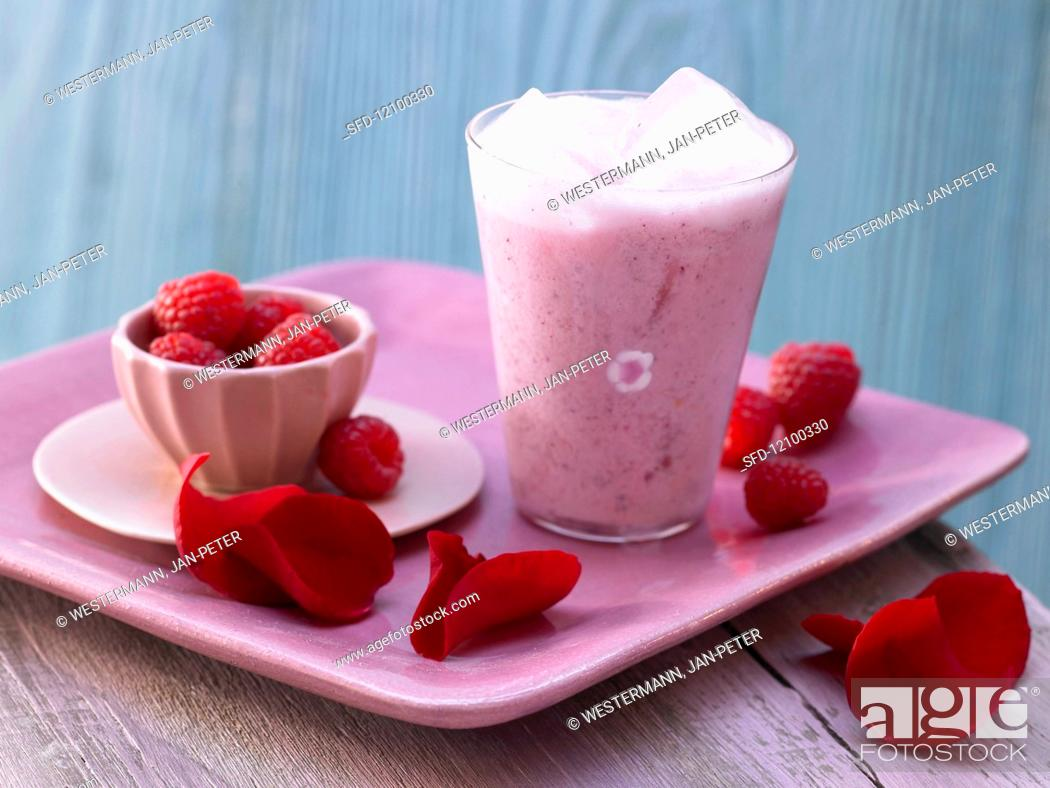 Stock Photo: Rose blossom milk mix with raspberries.