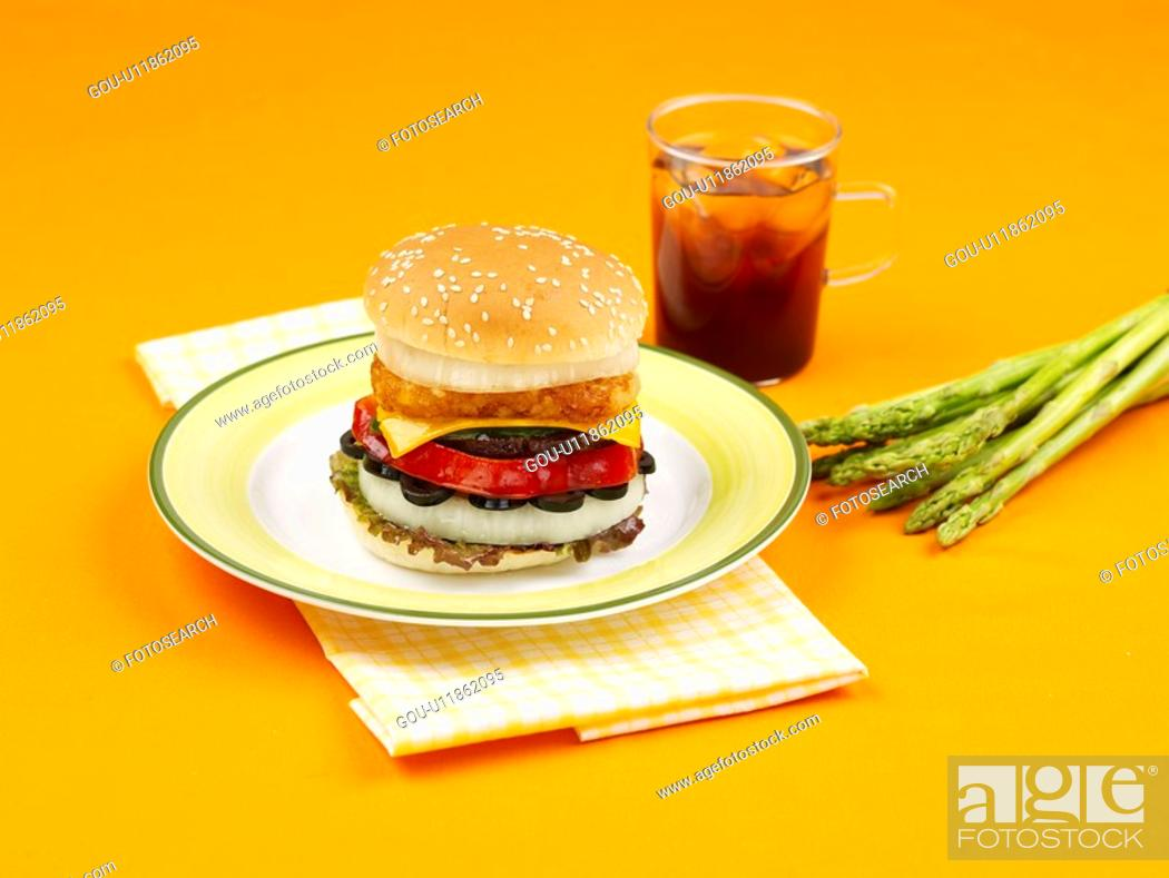Stock Photo: asparagus, dish, table mat, napkin, plate, coffee cup, cheese burger.