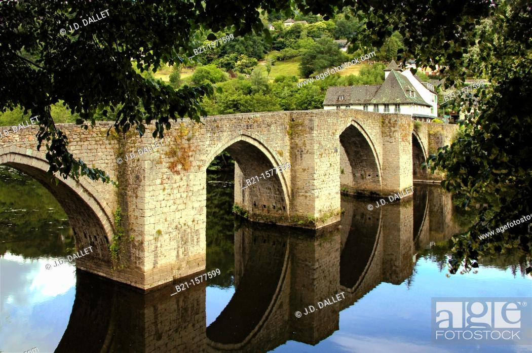 Stock Photo: Pilgrimage way to Santiago de Compostela: medieval bridge at the village of Entraygues on the Truyere river, Aveyron, France.