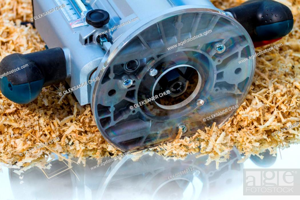 Stock Photo: variable speed plunge router on sawdust background.