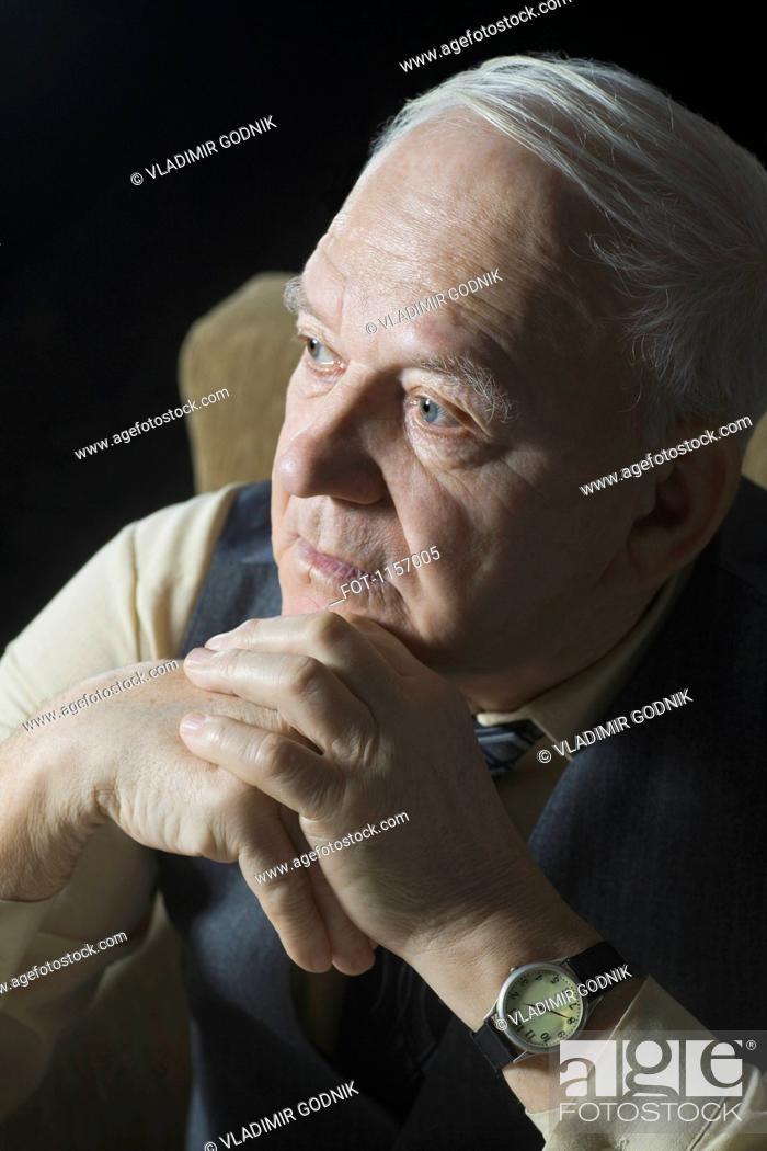 Stock Photo: A senior man looking away.