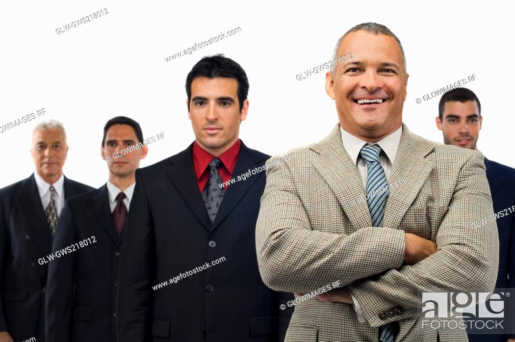 Stock Photo: Portrait of a businessman smiling with four businessmen standing behind him.