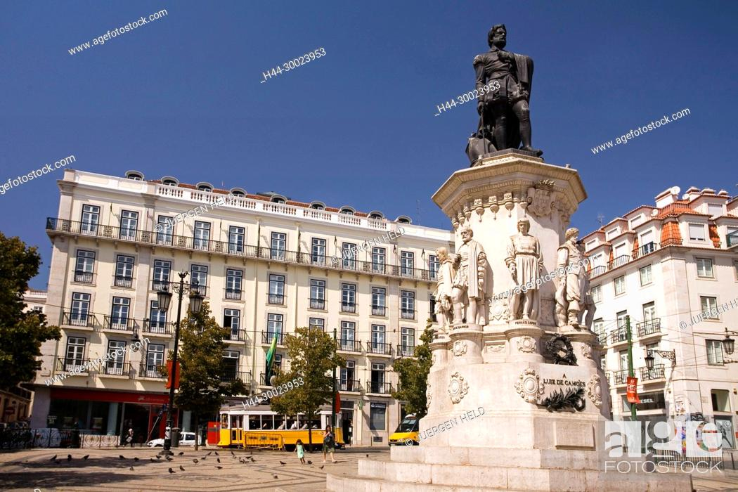 Stock Photo: Portugal, Lisbon, statue by Luiz de Camoes , yellow tram, electrico , Barrio Alto.