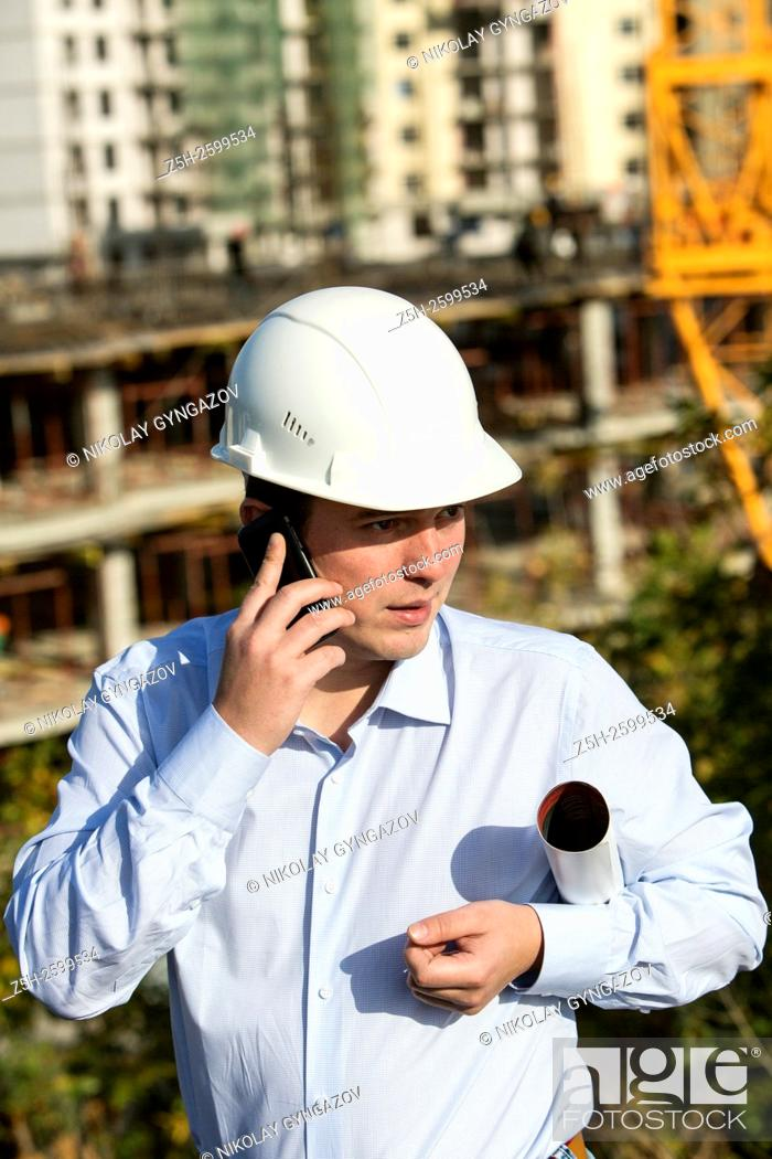 Stock Photo: Russian Federation. Belgorod. Young engineer on a construction site.
